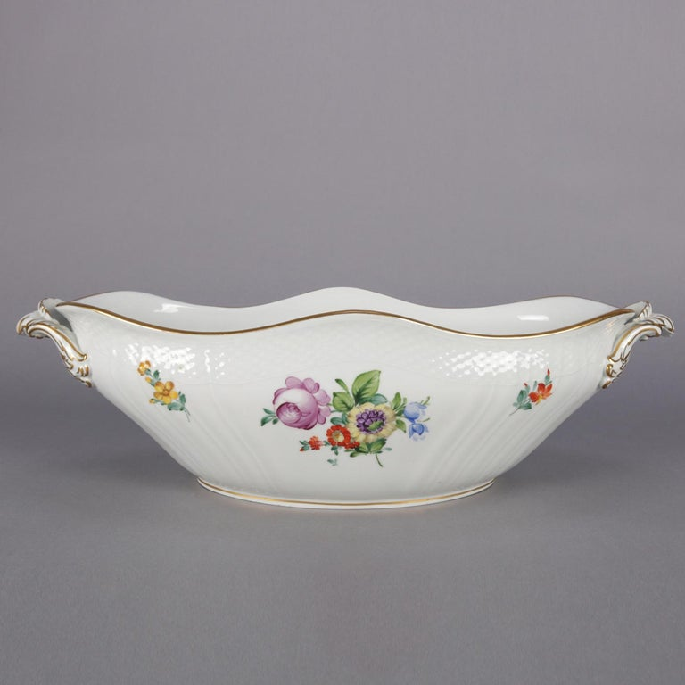 Danish Royal Copenhagen porcelain center bowl features scalloped oval form with double handles and decorated with hand-painted floral sprays inside and out, trimmed in gilt, reminiscent of Fora Danica, marked on base as photographed, 20th