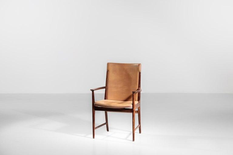 Rare Danish armchair by designer Kai Lyngfeldt Larsen in rosewood. Seat in leather and beautiful patina. Soren Willadsen Mobelfabrik.