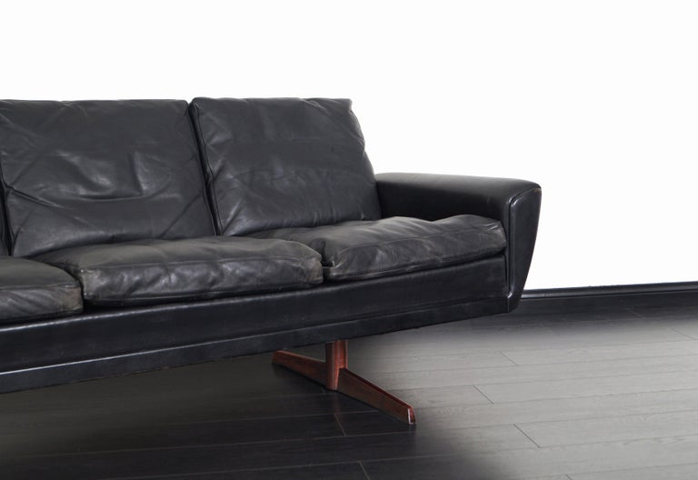 Mid-Century Modern Danish Leather and Rosewood Wingback Sofa by Georg Thams For Sale