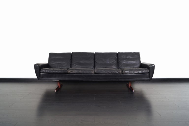 Danish Leather and Rosewood Wingback Sofa by Georg Thams In Good Condition For Sale In Burbank, CA