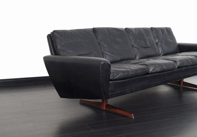 Late 20th Century Danish Leather and Rosewood Wingback Sofa by Georg Thams For Sale