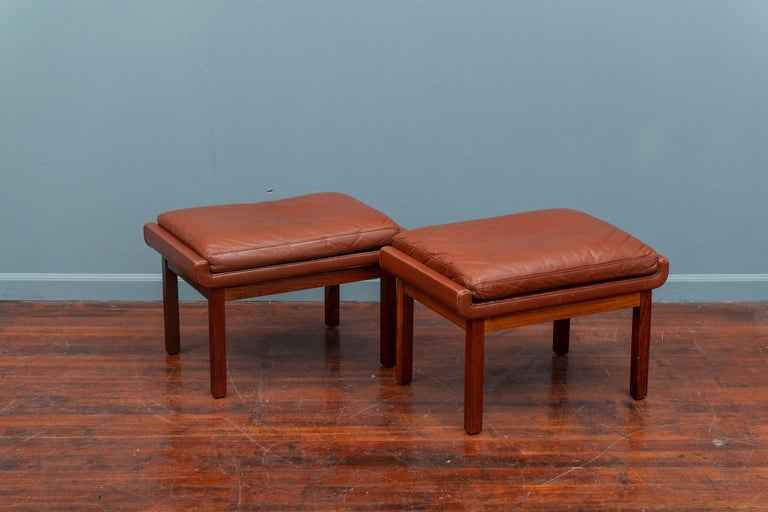 Pair of Danish rosewood and cognac leather ottoman.