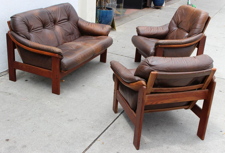 Danish 1970s living room set teak wood and leather .Two chairs are different dimension.
