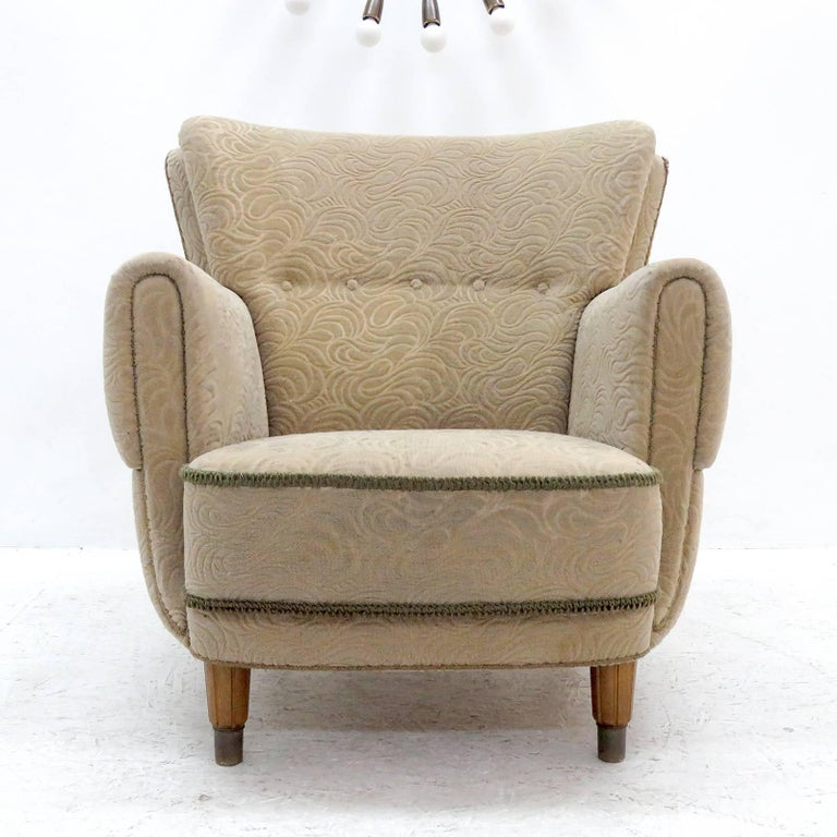 Wonderful 1940s Danish lounge chair in original floral textured mohair upholstery on spring supported seat and tufted, buttoned back, textured wooden feet with brass caps.