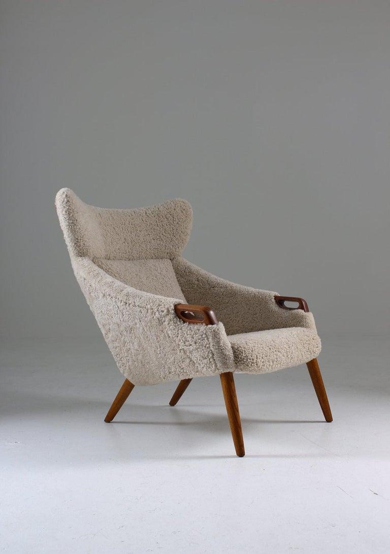Scandinavian Modern Danish Lounge Chair in Sheepskin, Model 55 by Kurt Østervig For Sale