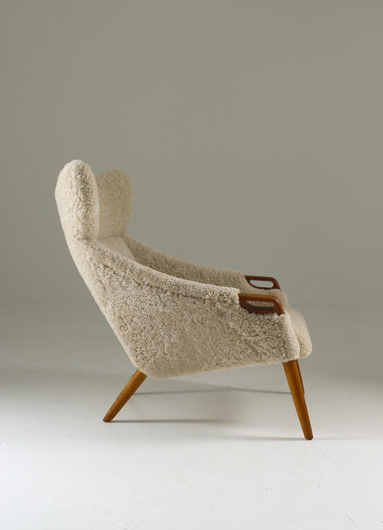 Danish Lounge Chair in Sheepskin, Model 55 by Kurt Østervig In Good Condition For Sale In Karlstad, SE