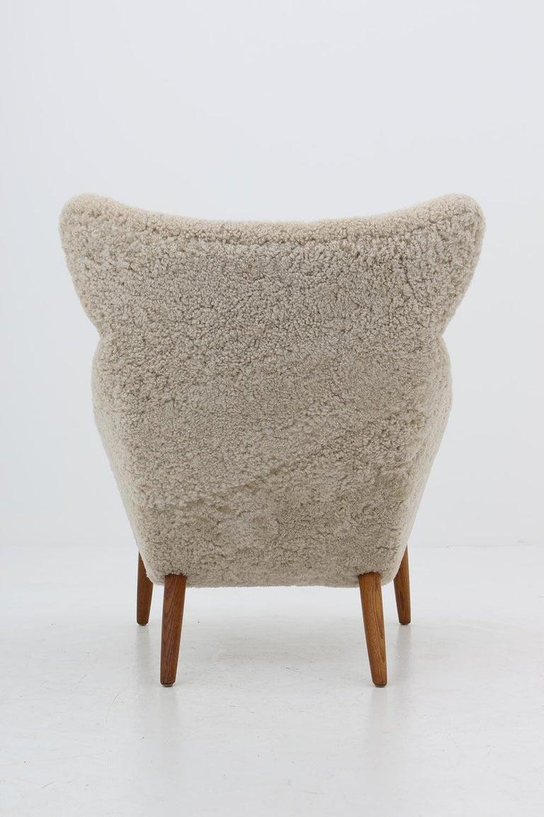 Teak Danish Lounge Chair in Sheepskin, Model 55 by Kurt Østervig For Sale