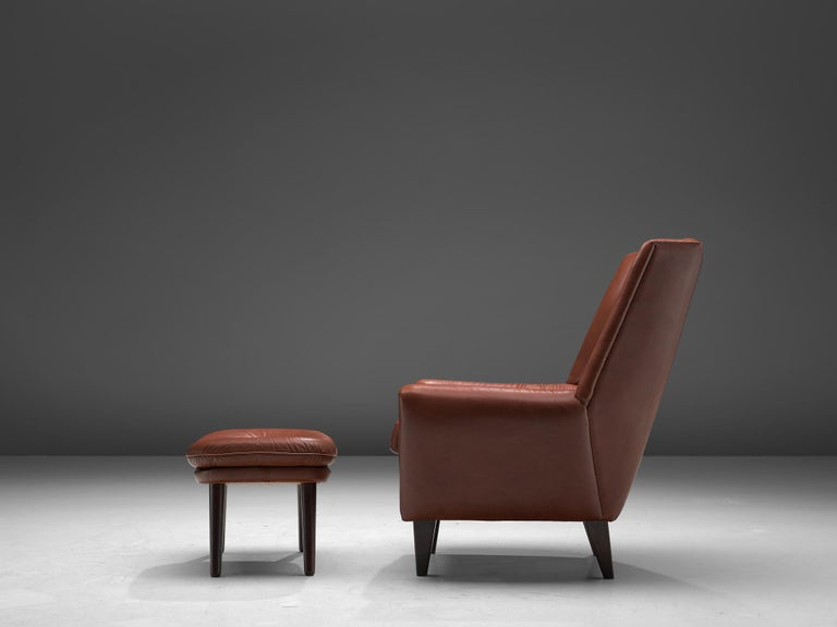 Scandinavian Modern Danish Lounge Chair with Ottoman in Leather For Sale