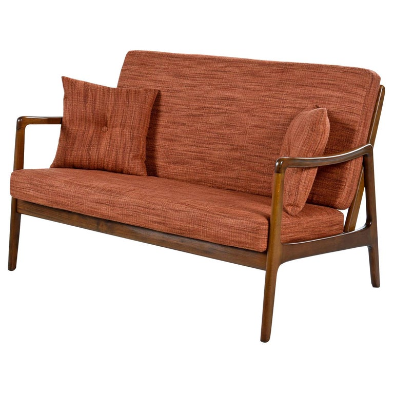 We are pleased to present this rare Danish settee by Ole Wanscher for Fance & Daverkosen. Collectors will recognize these names as Ole Wanscher is one of the most sought after names in Danish Modern design. This loveseat size sofa from maker France