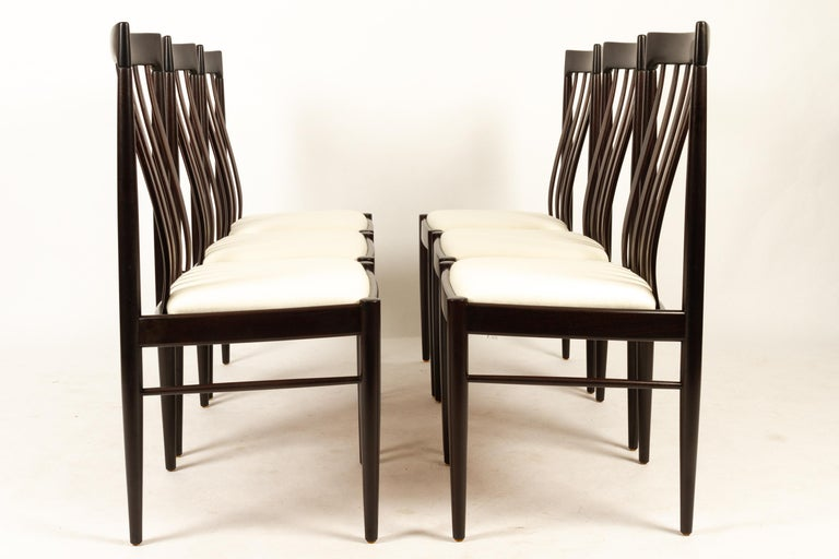 Danish mahogany dining chairs by H. W. Klein for Bramin 1970s set of 6. Set of six elegant dining chairs in solid stained mahogany. High back with thin curved bars. Seat is reupholstered in eggshell colored wool, with high density foam for extra