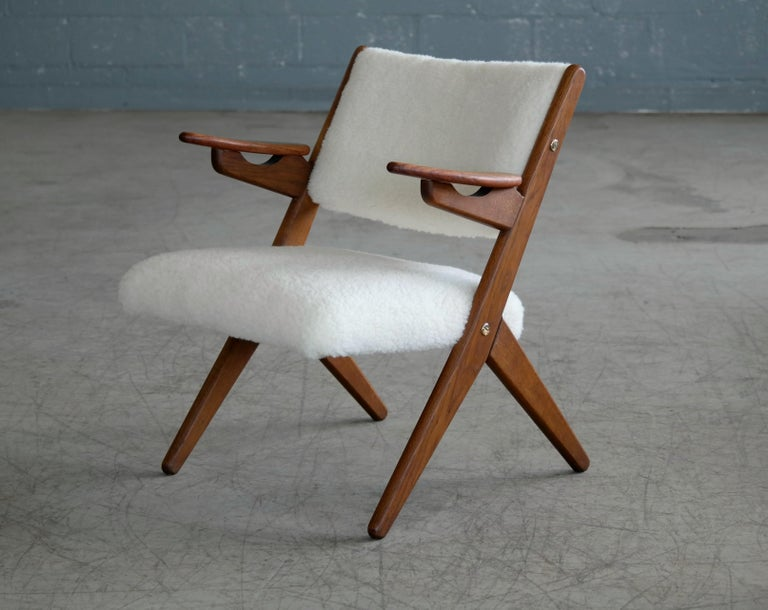 Sculptural and very beautiful 1950s easy chair made from solid teak with nice grain and color designed by Danish Designer, Arne Hovmand-Olsen. The wood frame shows appropriate age wear with minor scuffing and scratches and patina and surface wear on