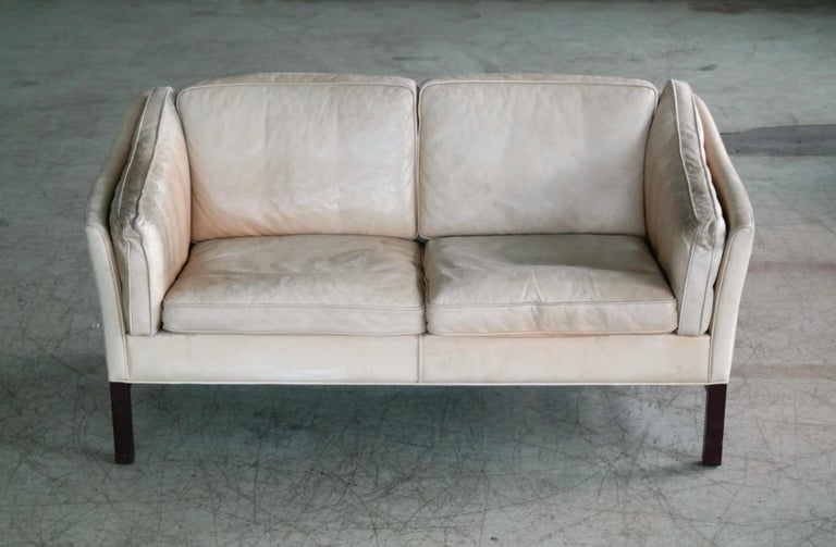 Late 20th Century Danish Midcentury Illum Wikkelso Attributed, Two-Seat Sofa in Worn Tan Leather For Sale