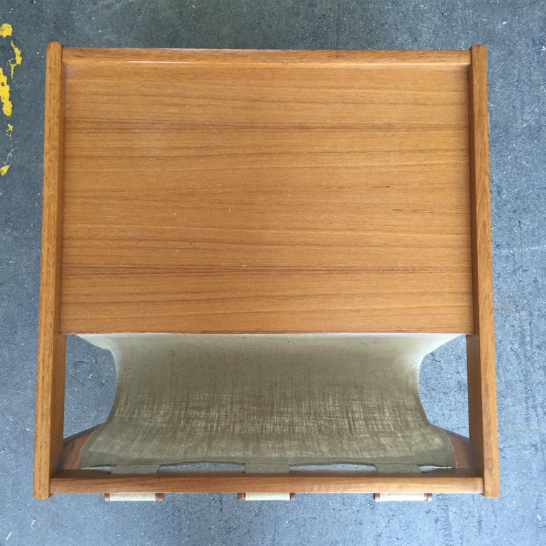 Midcentury side table made out of maple wood and eggshell cream linen. Can be used to store newspaper, magazines, books, records to name a few. Side table would also work well as a nightstand.