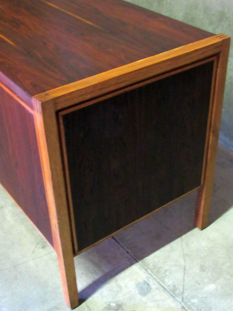 1960s Jacaranda, Rosewood & Teak Mid-Century Modern Desk from Columbia, South America.   Three teal drawers on the right have carved finger handles that inset into the face of the drawers.  The front and sides of the desk are made of Rosewood
