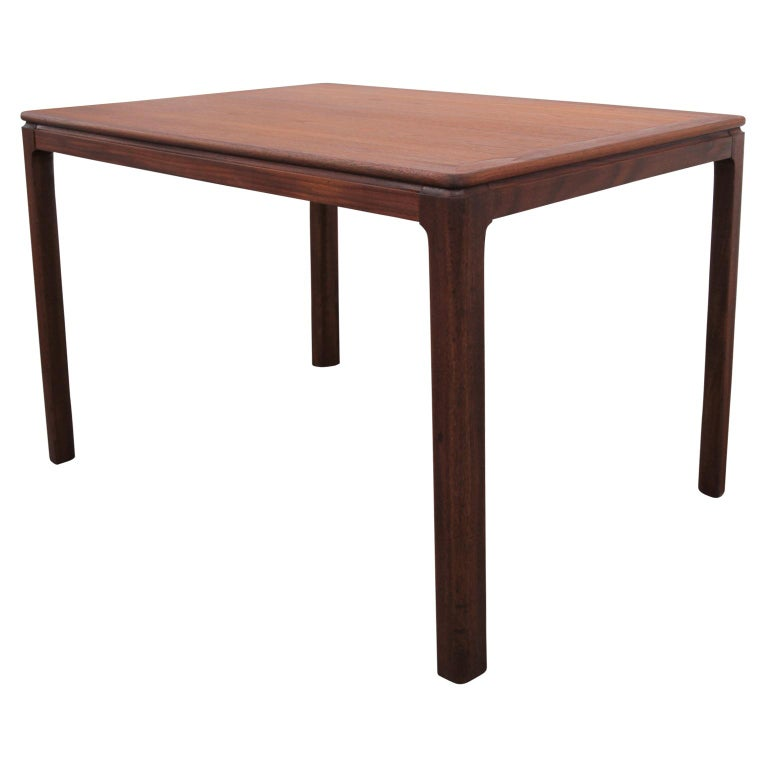 Danish rectangular side table in the Mid-Century Modern style. The tabletop and legs are beautifully constructed from teak. Restored.