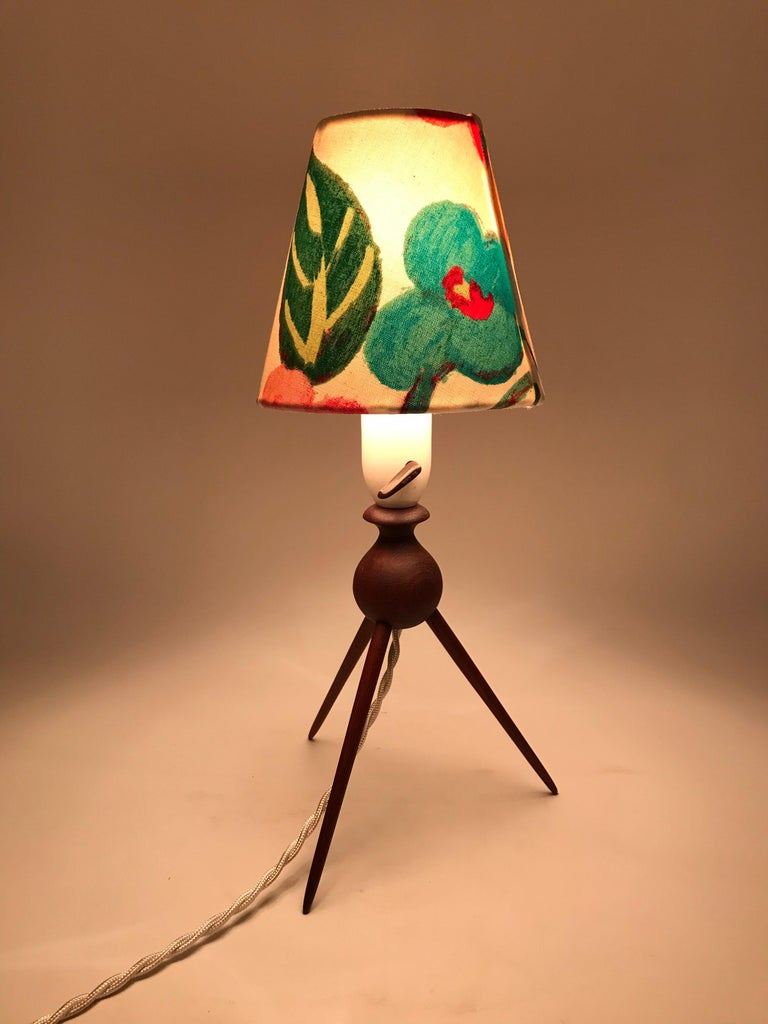 Danish Mid-Century Modern teak table lamp with a beautiful limited edition lampshade from ArtbyMaj. This solid teak lamp sits on 3 turned legs. It still has the original Bakelite bulb holder and is rewired. A plug can be fitted for the Eu or US