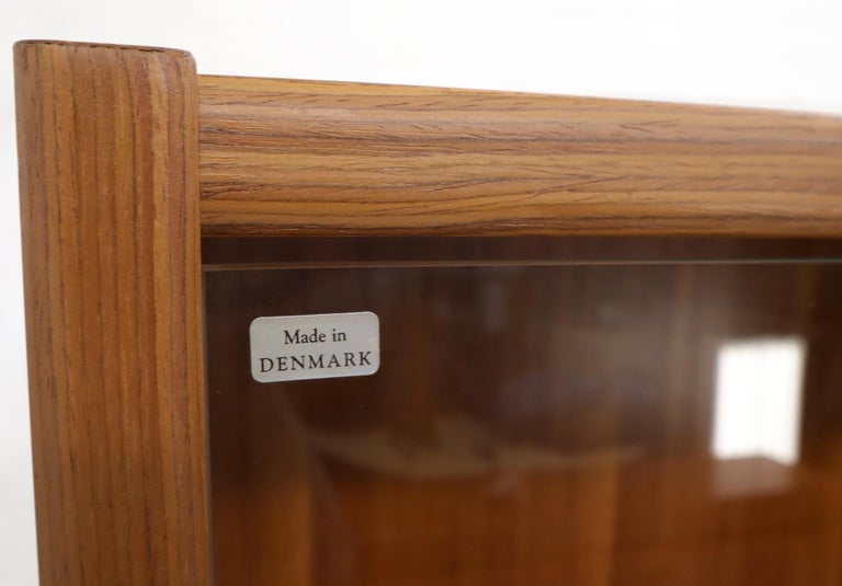 Lacquered Danish Mid-Century Modern Teak Wall Unit with Glass Doors Bottom Compartments For Sale
