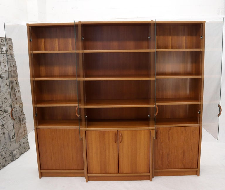 20th Century Danish Mid-Century Modern Teak Wall Unit with Glass Doors Bottom Compartments For Sale