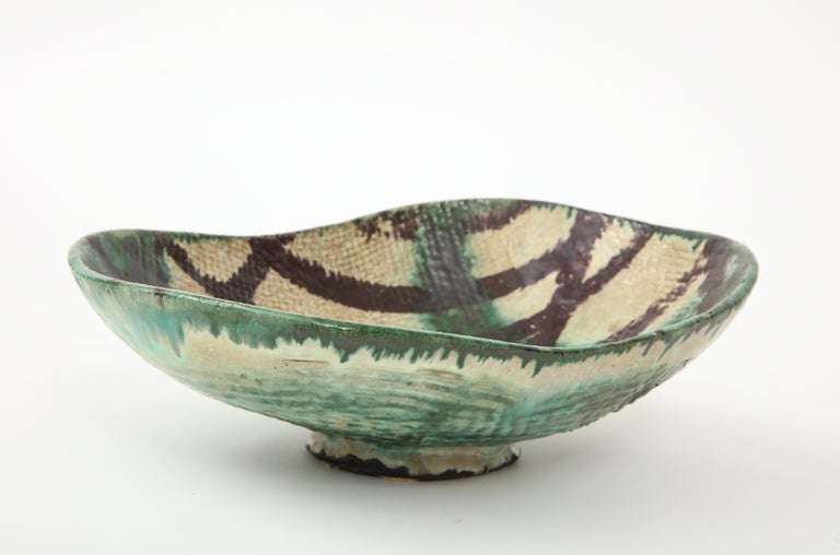 Danish midcentury ceramic bowl, oblong footed with green and black glaze. Signed and dated, Allan Ebeling, 1957.