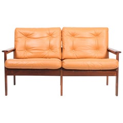 Danish Midcentury Sofa in Leather and Rosewood by Illum Wikkelsø