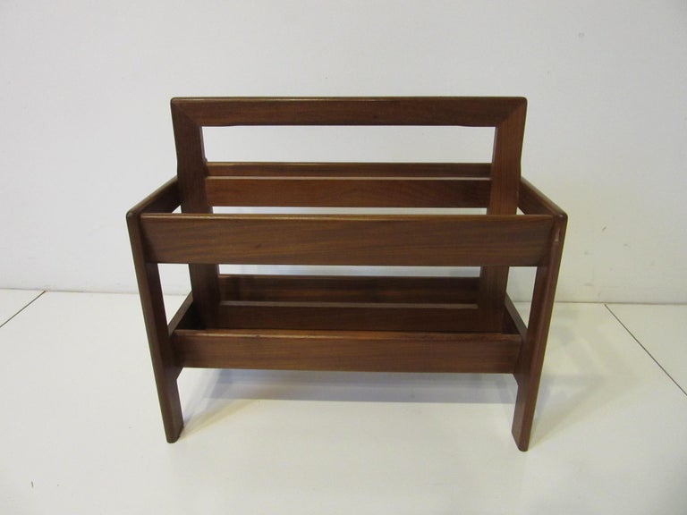 A very well crafted solid teak wood midcentury magazine rack with rounded edges built in handle and two large slots for your reading materials. Manufactured in Denmark.