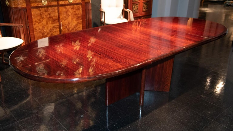 A danish mid-20th century dining or conference table in rich grained rosewood.