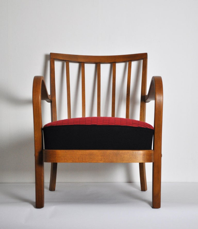 Danish cabinetmaker armchair attributed to Fritz Hansen, early 20th century, renovated. Upholstered in a fine condition.  Dimensions: 65 W x 72 D x 76,5 H cm Seat height 43 cm.