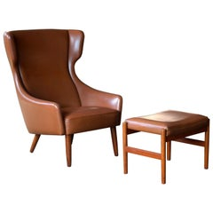 Danish Midcentury Cognac Colored Highback Lounge Chair with Ottoman by Spottrup
