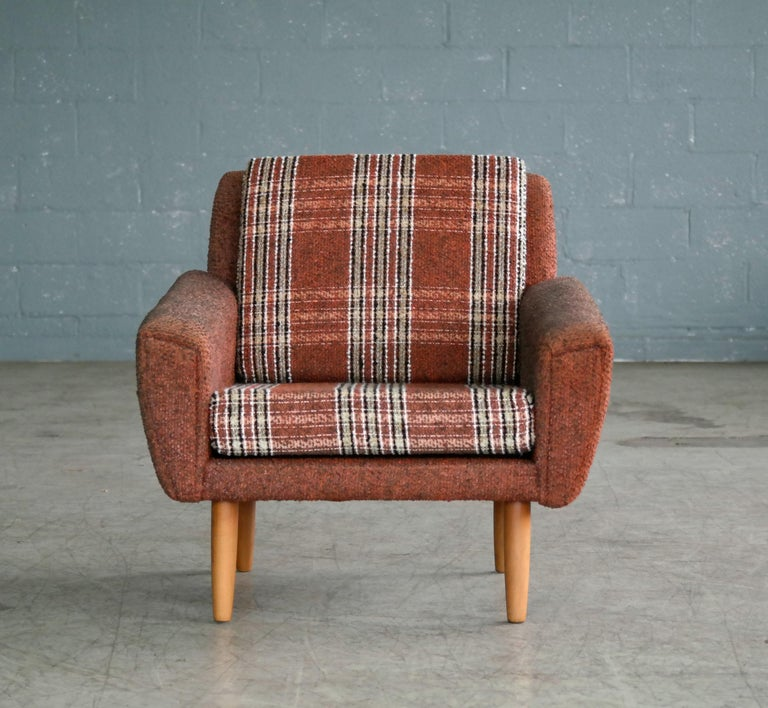 Classic 1960s easy chair possibly designed by Kurt Østervig for Ryesberg Mobler. The chair bears strong resemblance to Ostervig's characteristic design with tear drop front panels continuing to the backside of the chair but we are unsure of the