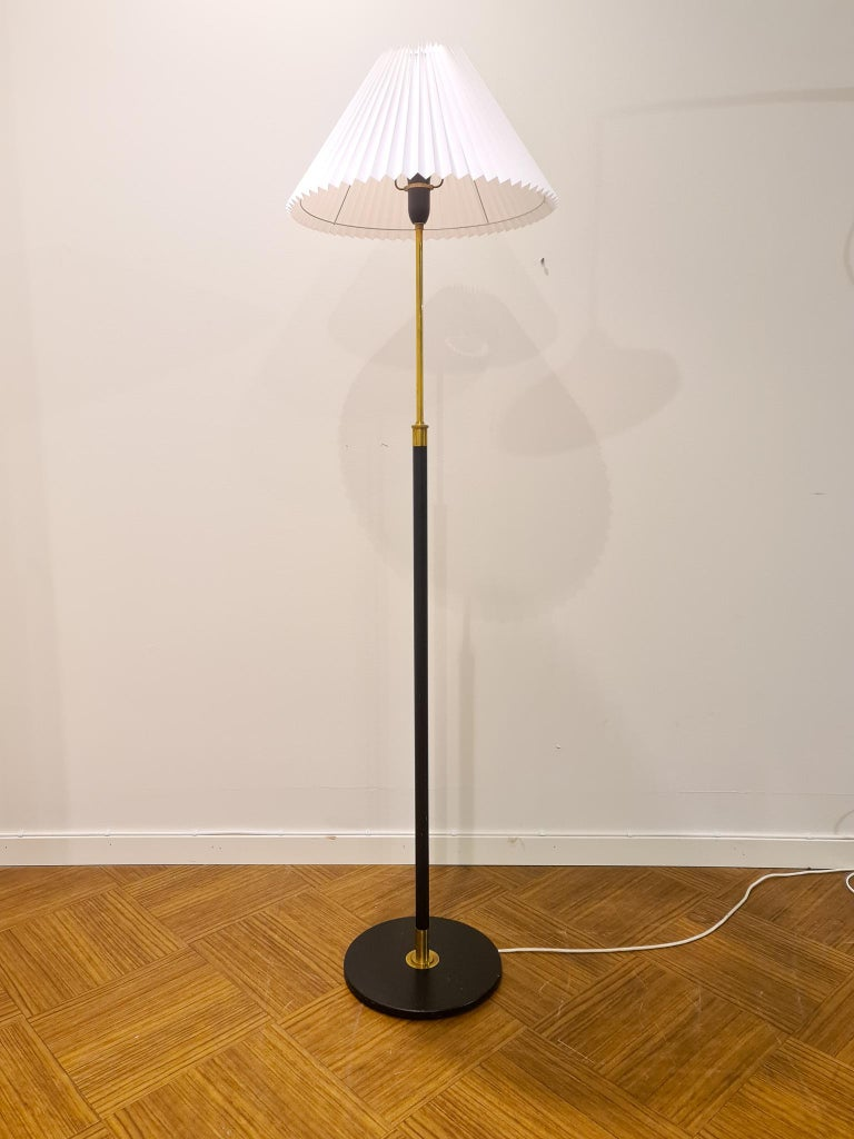 Wonderful adjustable floor lamp designed by Aage Petersen in Denmark. This one was produced in the 1970s. This one is made in brass with a possibility to adjust the height.  Good vintage condition, rewired. Marks of use on the