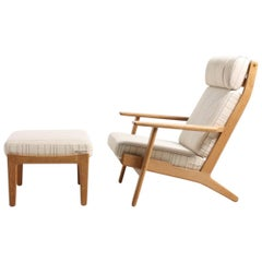Danish Midcentury Lounge Chair and Stool in Oak by Hans J. Wegner