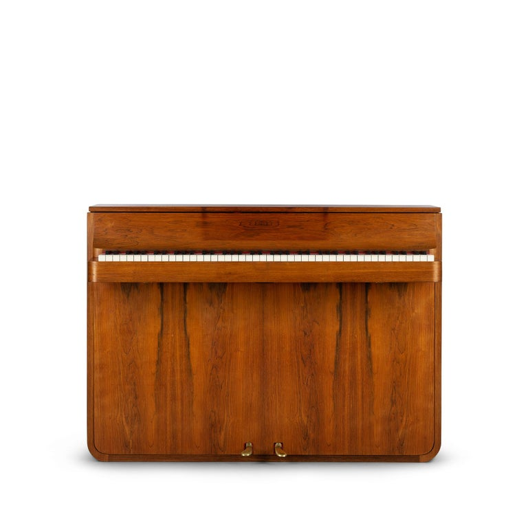 A rare Danish midcentury pianette made of magnificent hardwood. It is called pianette due to the 82 keys rather than the standard 88 of a full size piano. This pianette is made by renowned piano maker Louis Zwicki. Every piano from Louis Zwicki is