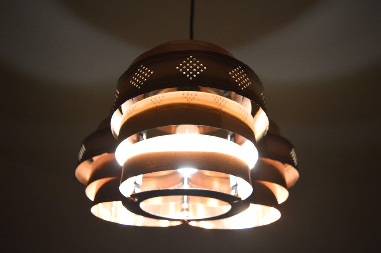 Copper pendant by Verner Schou for Coronell Elektro, Denmark. Perforated copper lamellae. Very beautiful style of lighting.