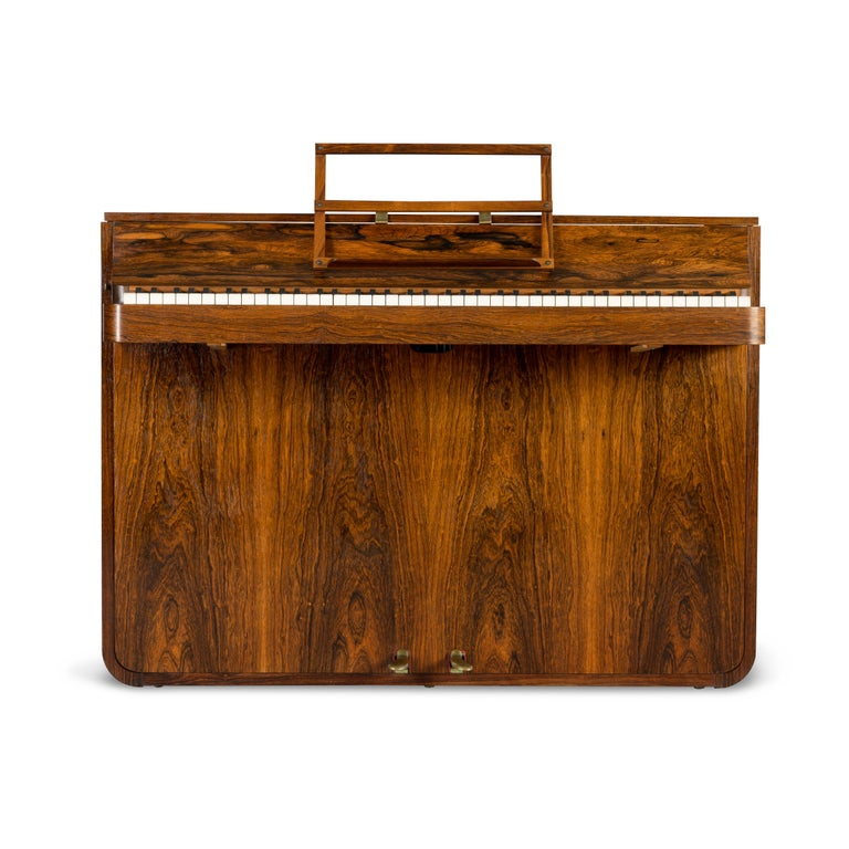 A rare Danish midcentury pianette made of magnificent rosewood. It is called pianette due to the 82 keys rather than the standard 88 of a full size piano. This pianette is made by renowned piano maker Louis Zwicki. Every piano from Louis Zwicki is