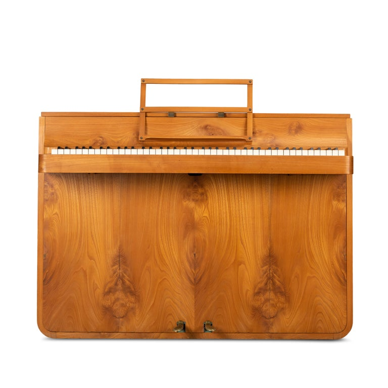 A rare Danish midcentury pianette made of magnificent oak. It is called pianette due to the 82 keys rather than the standard 88 of a full size piano. This pianette is made by renowned piano maker Louis Zwicki. This piece stands out in a modern