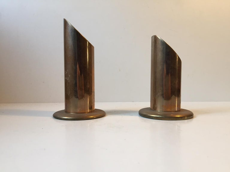 A pair of heavy brass candle holders. Manufactured by Danalux in Denmark in the 1960s. The candleholders can be fitted with either tea lights or large/bloc candles.
