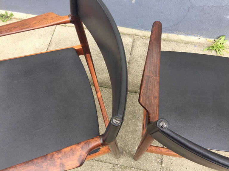 Pair of rare Danish Modern armchairs designed by Erik Wørts in 1960 and manufactured by Vamo in Denmark. This model is called 'Erika' and was Wørts favorite design. The pair feature solid Brazilian rosewood frames with black nappa upholstery