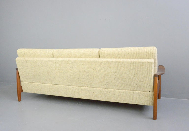 Danish midcentury sofa, circa 1960s  - Original upholstery - Teak frame - Folds into a daybed - Danish, 1960s - Measures: 208cm wide x 83cm deep x 80cm tall - 42cm seat height  Condition report:  Very minimal cosmetic wear.