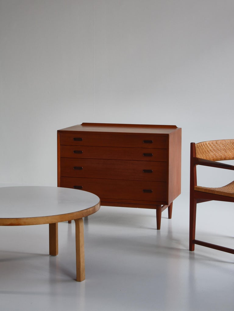 Beautiful small sideboard or dresser made in the early 1960s at Sibast Furniture, Denmark. Designed by Arne Vodder. This model in teakwood with 4 drawers is very rarely seen. Great vintage condition with few signs of wear. Marked