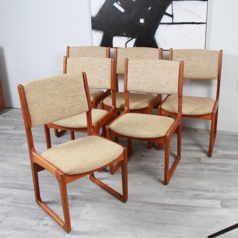 Relatively rare set (except on 1stdibs) of Benny LInden, square sided, solid teak dining chairs from the 70s. Cleann upholstery, but in need of modern updating, this set can easily break out of the Danish modern aesthetic and surround almost any