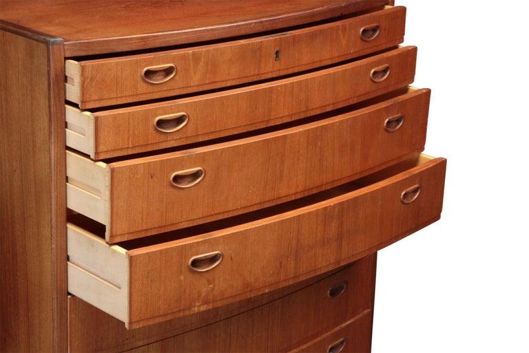 Mid-Century Modern Danish Modern Bow Front Highboy Dresser in Teak For Sale