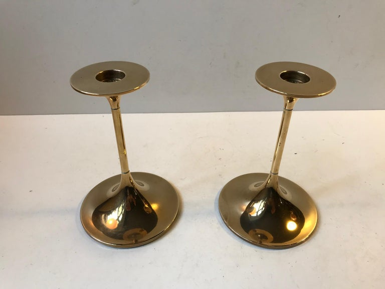 A pair of solid brass candlesticks designed by Architect Max Bruel. The model is called Hi-Fi and was manufactured by Torben Orskov in Denmark during the 1960s. They are imprinted from the manufacturer, both to the top and bottom. Although the
