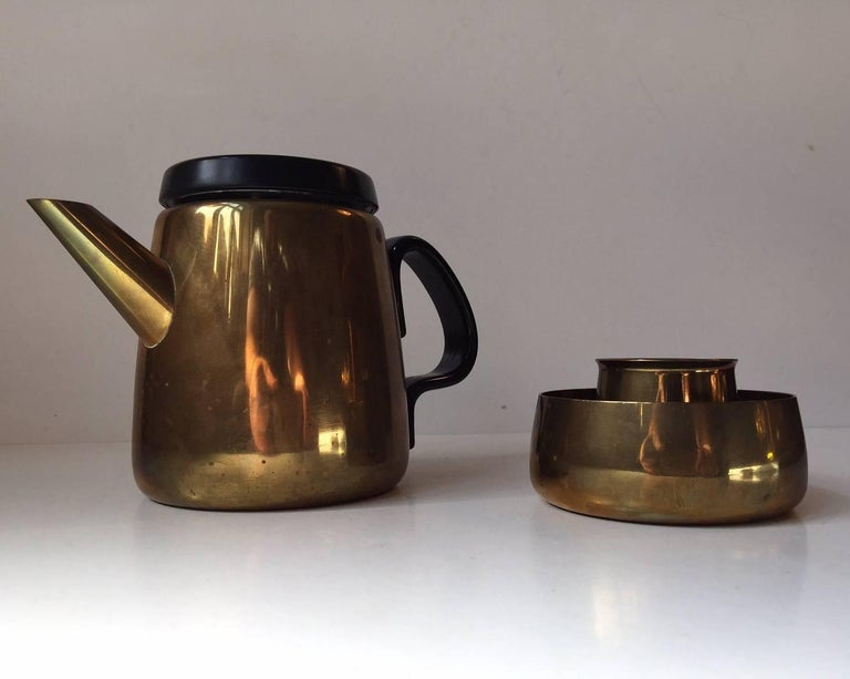 This spectacular Danish modern 3-piece brass tea or Mocaa set is designed Danish Architect and Silversmith Henning Koppel and manufactured by Georg Jensen in Denmark during the 1950s. Its simplicity at its best! It's in great vintage condition with