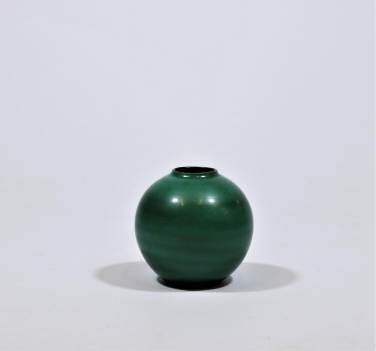 Elegant and organic shaped vase in green shades handmade by Nils Thorsson at Royal Copenhagen, Denmark in 1944.