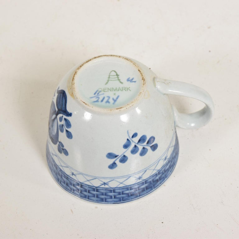 For your consideration, a coffee tea cups and plates set for (12) twelve person. Beautifully decorated in royal blue, making a great contract with eh white porcelain.   Stamped underneath with the makers' symbols. Stamped DENMARK.  Dimensions: