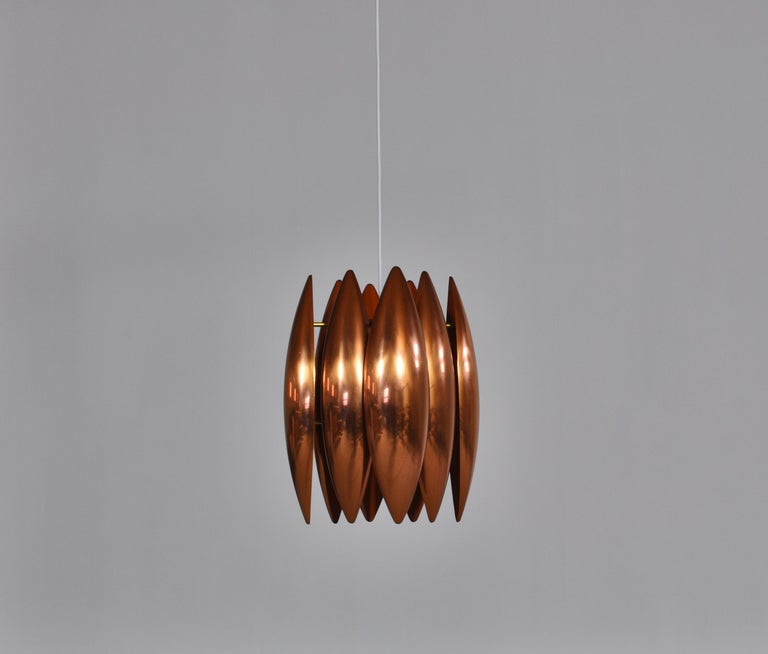 Impressive copper pendant by Danish designer Jo Hammerborg. The lamp was made in the late 1960s for Fog & Mørup, Copenhagen. Hammerborg was educated as a silver smith and this is clearly seen in many of his designs. Brutalism and Danish modern is
