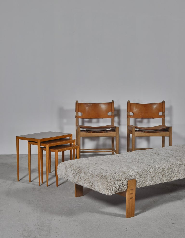 Beautiful daybed designed by Eva & Nils Koppel for The Technical University of Denmark in the 1960s. The frame is in solid oak and the seat has been reupholstered in soft and curly sheepskin. The model was never put into production and was only made