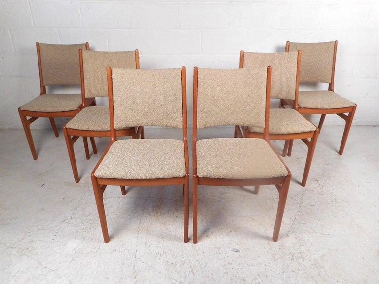 Beautiful set of 6 Danish modern style dining chairs made by D-scan. Teak wood construction with handsome joinery showcased on the frames. Stylish set sure to impress in any modern interior. Please confirm item location with dealer (NJ or NY).