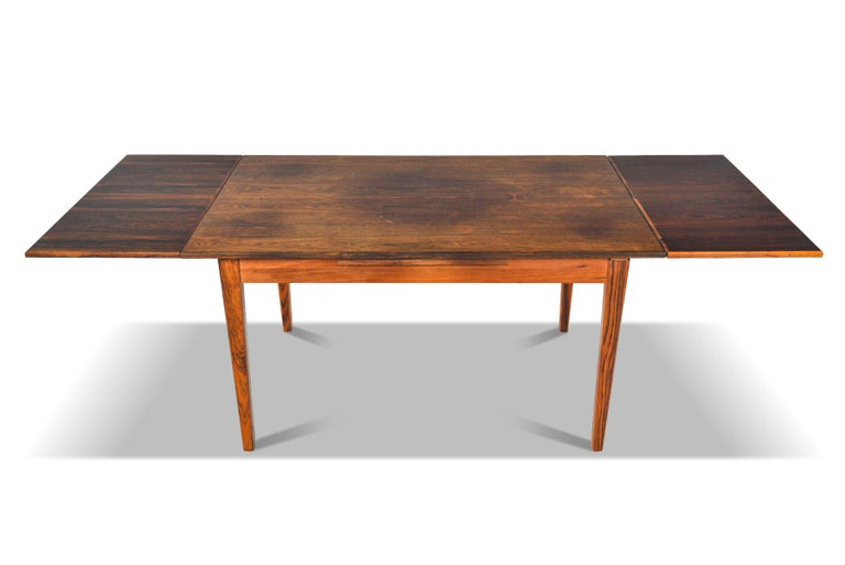 Scandinavian Modern Danish Modern Draw Leaf Rosewood Dining Table by E.W. Bach For Sale