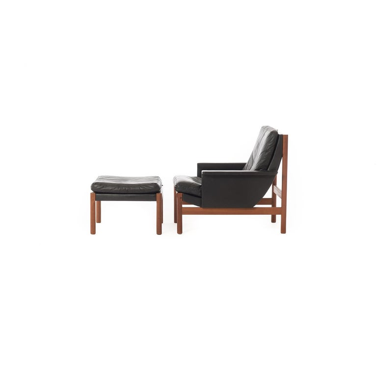 Oiled Danish Modern Easy Chair and Ottoman in Black Leather